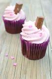 Creamy cupcakes. Creamy pink cupcakes with sprinkles Stock Image