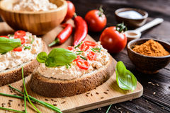 Creamy curd spread with chili, ground cumin, chive and basil Royalty Free Stock Images