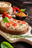Creamy curd spread with chili, ground cumin, chive and basil Royalty Free Stock Photo