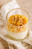 Creamy dessert with caramelized pears and nuts Royalty Free Stock Images
