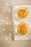Creamy dessert with caramelized pears and nuts Stock Image