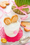 Creamy dessert with cookies in glass in the form of Easter bunny Stock Photo