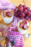 Creamy dessert with red grapes Stock Image