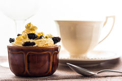 Creamy dessert sweet coffee cup black wooden board Royalty Free Stock Images