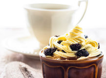 Creamy dessert sweet coffee cup black wooden board Royalty Free Stock Image