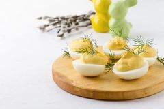 Creamy deviled eggs, Easter dinner appetizer. Creamy deviled eggs, delicious Easter dinner appetizer, close up, selective focus royalty free stock photo