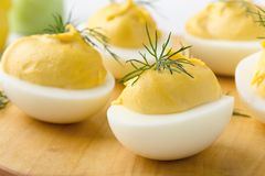 Creamy deviled eggs, Easter dinner appetizer. Creamy deviled eggs, delicious Easter dinner appetizer, close up, selective focus royalty free stock images
