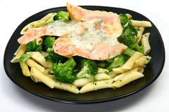 Creamy Dill Salmon. Salmon fillets over pasta and broccoli with dill sauce Royalty Free Stock Photo