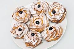 Creamy donuts Stock Photos