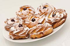 Creamy donuts Stock Images