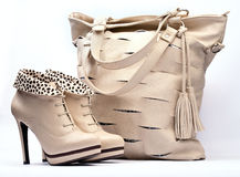 Creamy female boots and leather bag royalty free stock photography