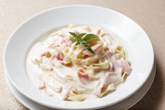 Creamy Fettuccine. Pasta with ham and parmesan royalty free stock photo