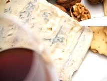 Creamy gorgonzola cheese, nuts, and biscuits Stock Photos