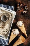 Creamy ice cream with chocolate crumbs in a waffle cone Royalty Free Stock Image