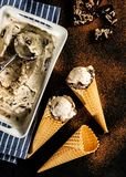 Creamy ice cream with chocolate crumbs in a waffle cone Stock Images