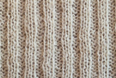 Creamy knitted wool warm clothes for the winter fabric texture b. Creamy wool knitted warm clothes for the winter fabric texture background Stock Photos