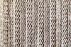 Creamy knitted wool warm clothes for the winter fabric texture b. Creamy wool knitted warm clothes for the winter fabric texture background Stock Photo