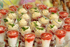Creamy layer desserts in glasses royalty free stock images