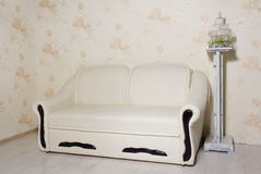 Creamy leather sofa in a empty room Stock Photography