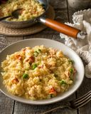 Creamy Lobster Risotto. A plate of delicious homemade lobster risotto with green peas royalty free stock image
