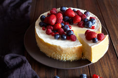Creamy mascarpone cheese cake with strawberry and winter berries. Christmas New York Cheesecake. Healthy food ration . Creamy mascarpone cheese cake with Stock Images