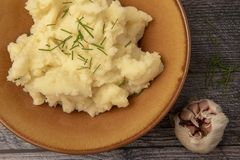 Creamy mash potato and garlic stock images