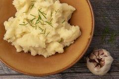 Creamy mash potato and garlic. Close up of creamy mash potato and garlic stock images