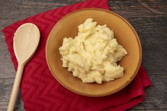 Creamy mash potato with wooden spoon royalty free stock photography