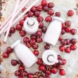 Creamy milk shake with cherries Stock Images