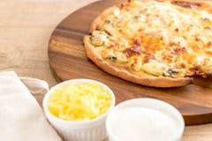 Creamy mushroom pizza. On wood tray Stock Photography