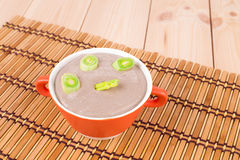 Creamy mushroom soup with green onion. Royalty Free Stock Images