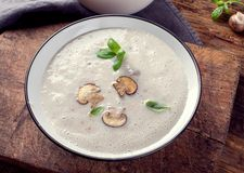 Creamy Mushroom Soup on rustic wooden table Stock Image