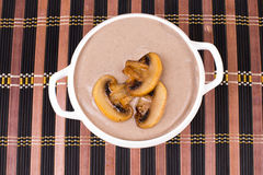 Creamy mushroom soup on top. Stock Images
