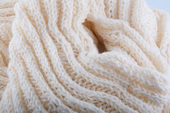 Creamy off-white handmade wool knitwork. Creamy off-white wool knitwork full frame for warming backdrop or background Royalty Free Stock Image
