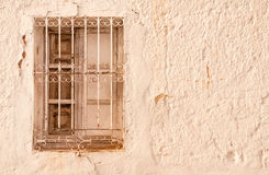 Creamy old wall with window Royalty Free Stock Photography
