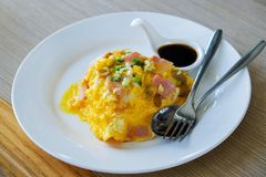 Creamy Omelet with Bacon on Rice royalty free stock photo