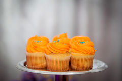 Creamy orange cupcakes on a platter Royalty Free Stock Images
