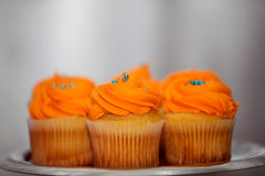Creamy orange cupcakes on a platter Royalty Free Stock Photography