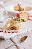 Creamy orange dessert serving on square cut plate Stock Images