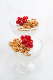 Creamy panna cotta with granola and berries on a white wood Royalty Free Stock Photo