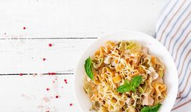 Creamy pasta with chicken and eggplant  served in deep plate. Royalty Free Stock Photography