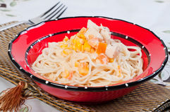 Creamy pasta with chicken, fresh tomatoes and corn Stock Photo
