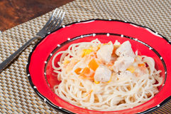 Creamy pasta with chicken, fresh tomatoes and corn Stock Photography