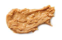 Creamy peanut butter. On white background royalty free stock photos