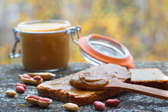 Creamy peanut butter in a jar stock photography