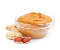 Creamy peanut butter with nuts Stock Images
