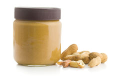 Creamy peanut butter and peanuts. Royalty Free Stock Photos