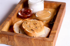 Creamy peanut butter on a slice of toast. Peanut butter sandwich Stock Image