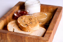 Creamy peanut butter on a slice of toast. Peanut butter sandwich Stock Photos