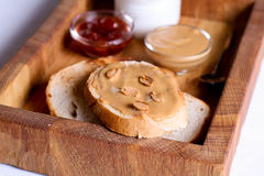 Creamy peanut butter on a slice of toast. Peanut butter sandwich Royalty Free Stock Images